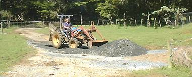 Stephan rearranging the washed-away gravel