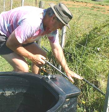 Stephan cuts through a water-line to install a new trough