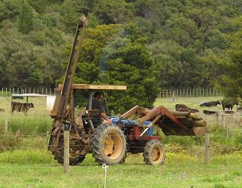 Tractor carrying fenceposts