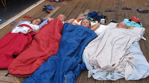 girls in sleepingbags on the deck