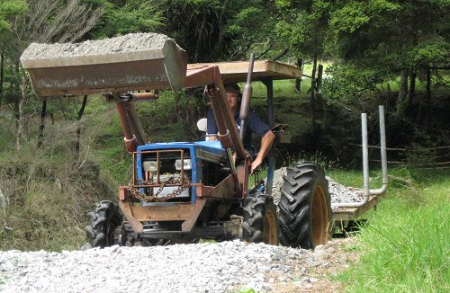 carrying track metal on the tractor