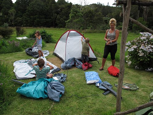 children setting up tents