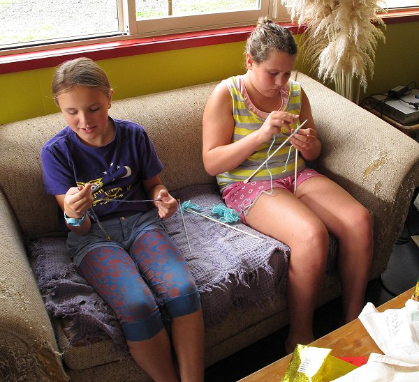 girls learning to knit