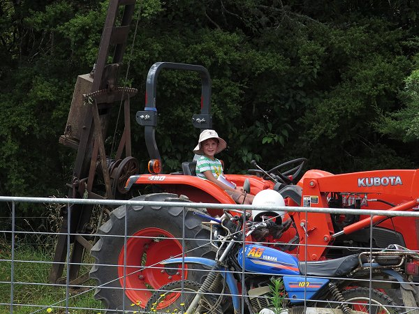 small boy on tractor
