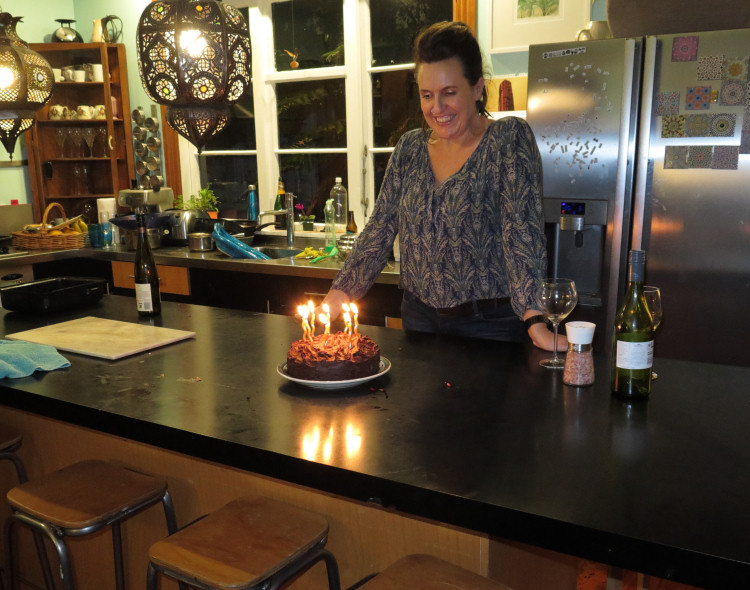 woman and birthday cake