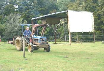 Stephan on the tractor, carrying the truck canopy