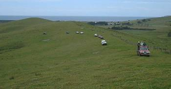A line of vehicles touring the Monitor Farm