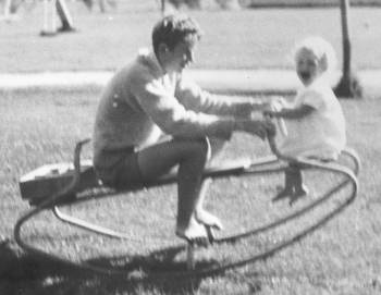 Ruth and Bruce on the garden see-saw